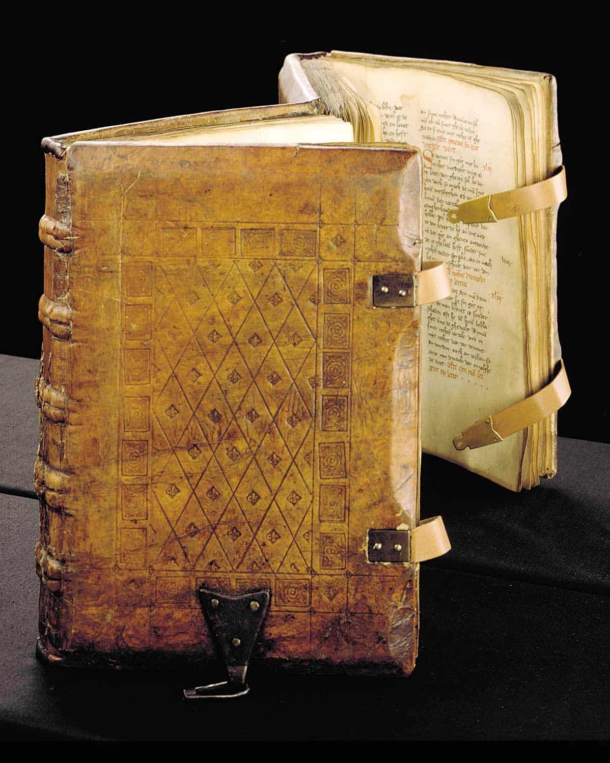 A 1385 copy of the Sachsenspiegel, a German legal code, written on parchment with straps and clasps on the binding